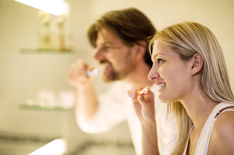 People brushing their teeth after learning proper technique at Bijan Family Dental Practice